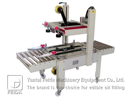Semiautomatic carton sealing ma